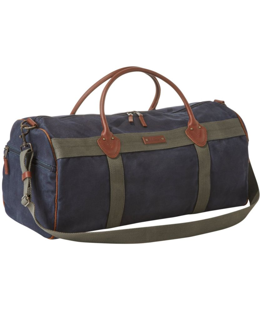We built our classic zippered duffle with real waxed canvas fabric that\\\'s even stronger and more rugged than ever. Spot clean. Crafted from authentic, weather-resistant waxed cotton canvas. Trimmed with 100% cotton webbing. Brushed cotton/polyester blend lining. Full-grain leather handles. Two external zip pockets for stowing smaller items. Small zippered pocket inside. Reinforced bottom for added durability. Large main compartment makes it easy to pack. Detachable, adjustable shoulder strap. Sturdy YKK zippers withstand the rigors of travel. Heritage-inspired print lining with topographical map design. Imported.