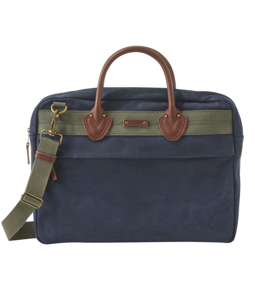 Expertly crafted in classic waxed canvas, this briefcase is the perfect combination of heritage style and modern features, including a padded laptop sleeve and plenty of pockets (inside and out) to keep you organized. Spot clean. Crafted from durable, weather-resistant waxed cotton canvas. Full-grain leather trim. Brushed cotton/polyester blend lining. Padded laptop or tablet sleeve; fits most 15\\\