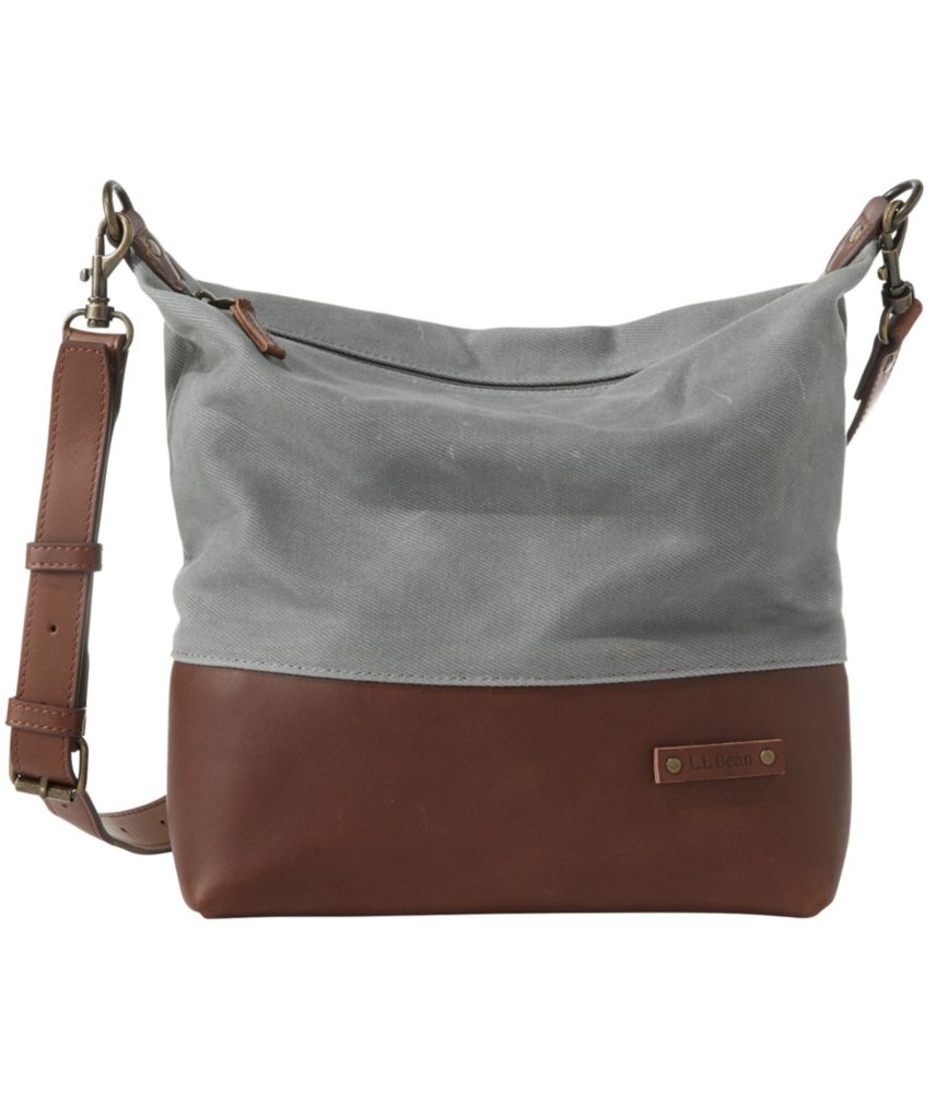 Expertly crafted in rugged, weather-resistant waxed canvas, this crossbody bag is the perfect combination of heritage style and modern features. Spot clean. Crafted from durable, weather-resistant waxed cotton canvas. Full-grain leather trim. Brushed cotton/polyester blend lining. Built-in organization and inside pockets help keep track of smaller items. Adjustable, detachable shoulder strap. Zippered top opening. Spacious main compartment. Imported.